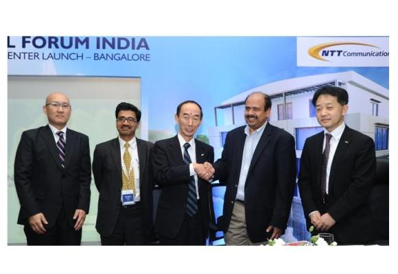 (center) Mr. Akira Arima - President & CEO, NTT Communications and Mr. S...